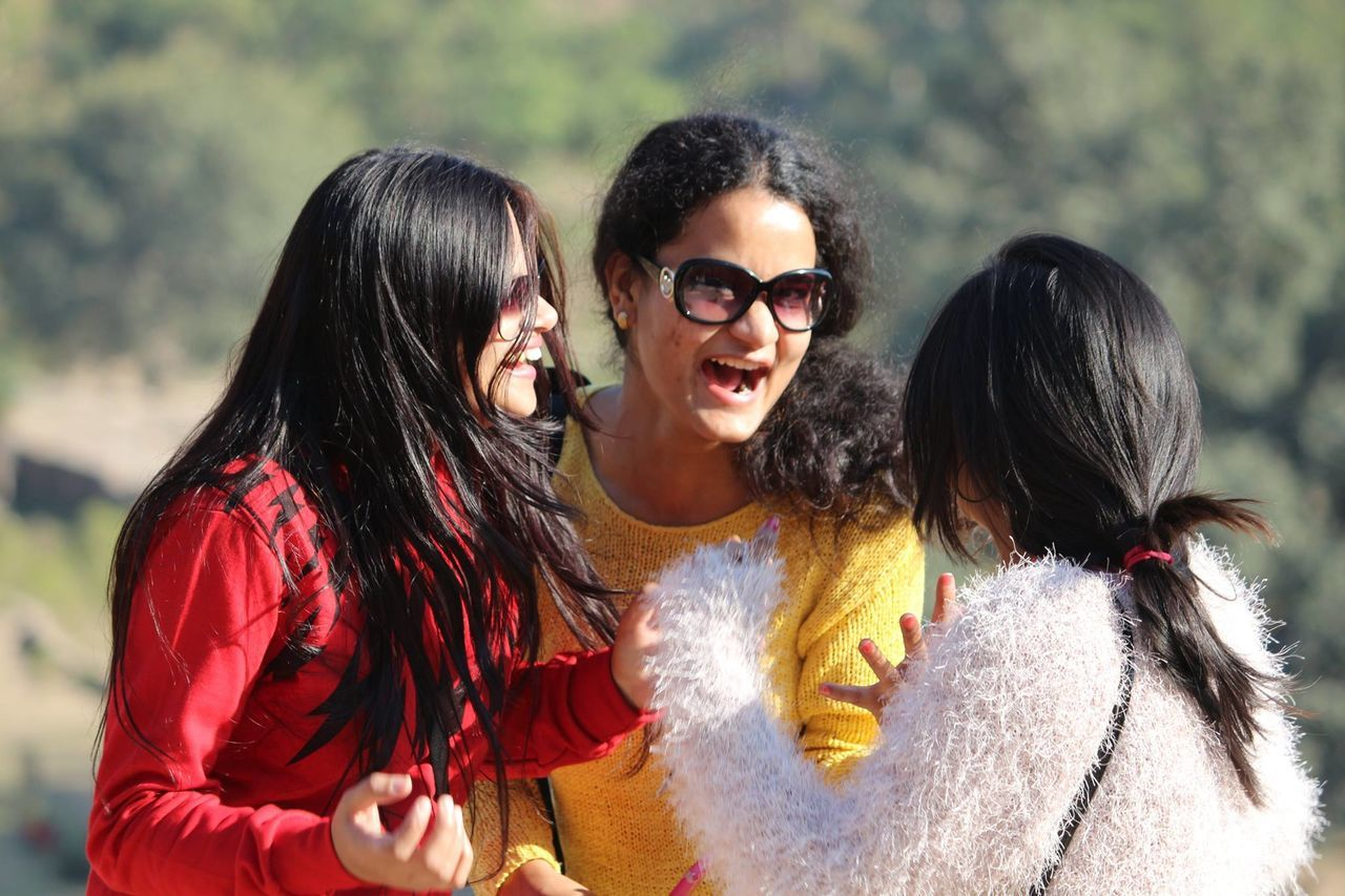 long hair, young adult, black hair, young women, friendship, real people, outdoors, leisure activity, togetherness, smiling, lifestyles, day, happiness, cheerful, bonding, women, standing, beautiful woman, beauty, adult, people, nature, adults only