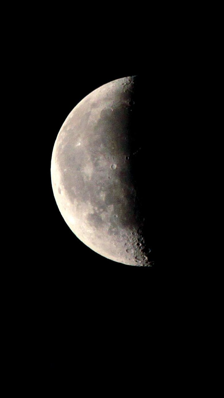 night, astronomy, moon, moon surface, planetary moon, beauty in nature, majestic, space exploration, nature, low angle view, space, scenics, tranquility, half moon, no people, tranquil scene, discovery, clear sky, outdoors, sky, close-up, satellite view