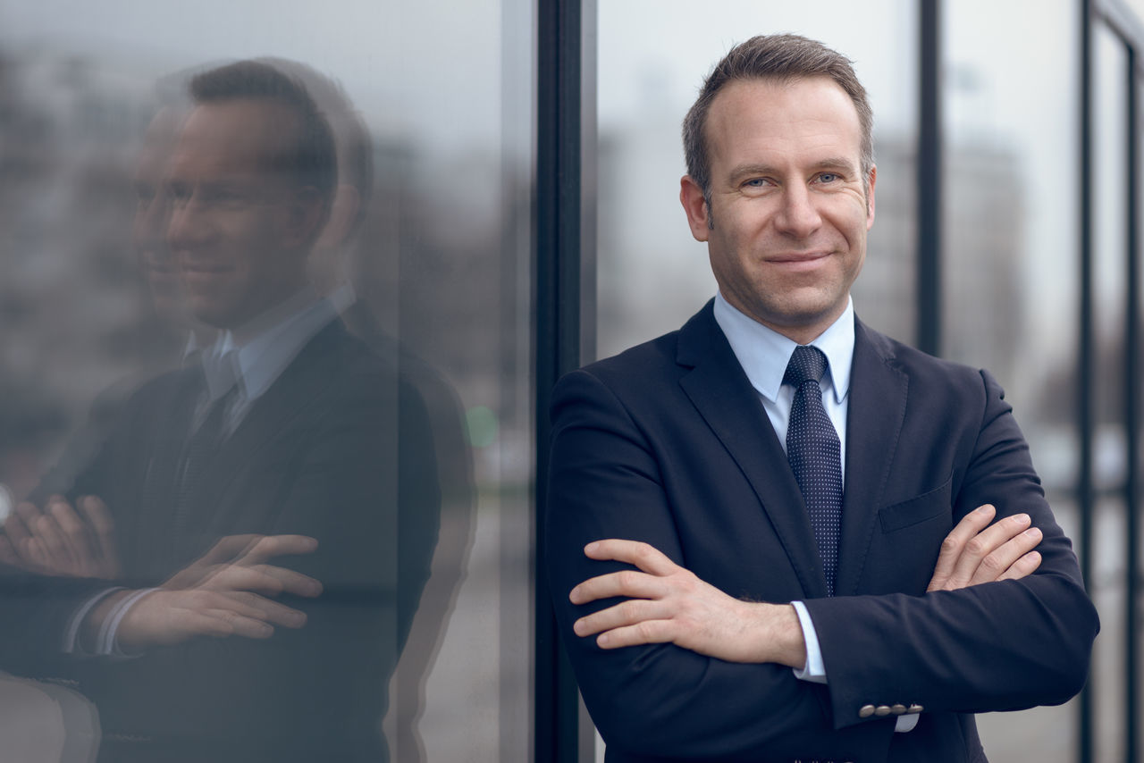 Friendly confident middle-aged business man Business Business Businessman Ceo Confidence  Confidence  Confident  Copy Space Friendly Male Man Management Manager Middle-aged Portrait Well-dressed