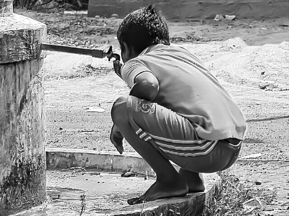 Save WaterThe Portraitist - 2016 EyeEm Awards Taking Time To See The Little Things The Street Photographer - 2016 EyeEm Awards Back And White Version Portrait Of Innocence At Road Simple Clothing Photo Of The Day Unknown People Looking At Things On Road Photography Street Photography My First Pic On EyeEm Casual Look Drinking Water Water Tank Child Portrait Child Photography Thirsty Little Boy. Drinking Water Tank The Photojournalist - 2016 EyeEm Awards Film Shot