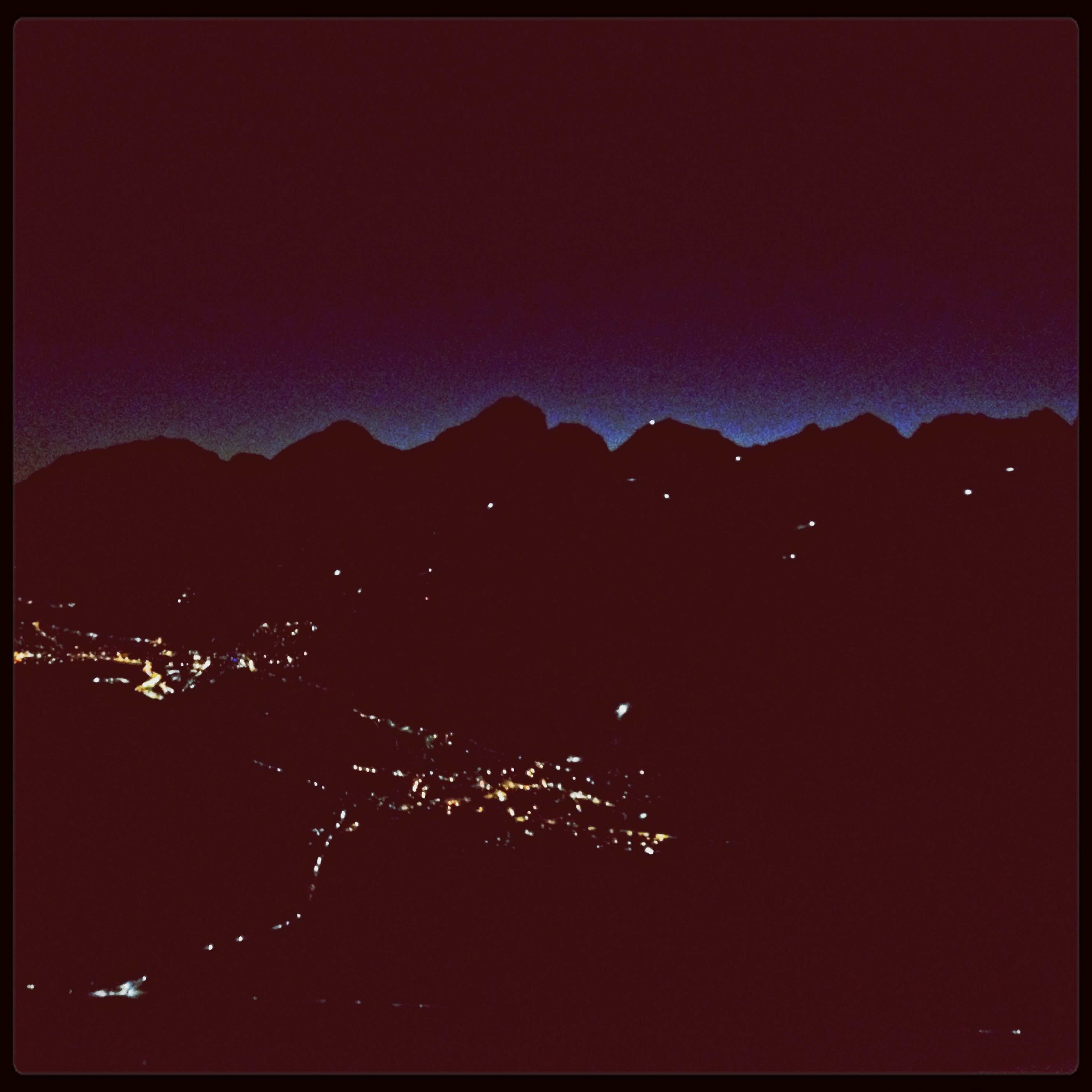 night, illuminated, mountain, mountain range, transfer print, sky, copy space, building exterior, clear sky, scenics, dusk, dark, built structure, auto post production filter, city, cityscape, architecture, silhouette, beauty in nature, landscape