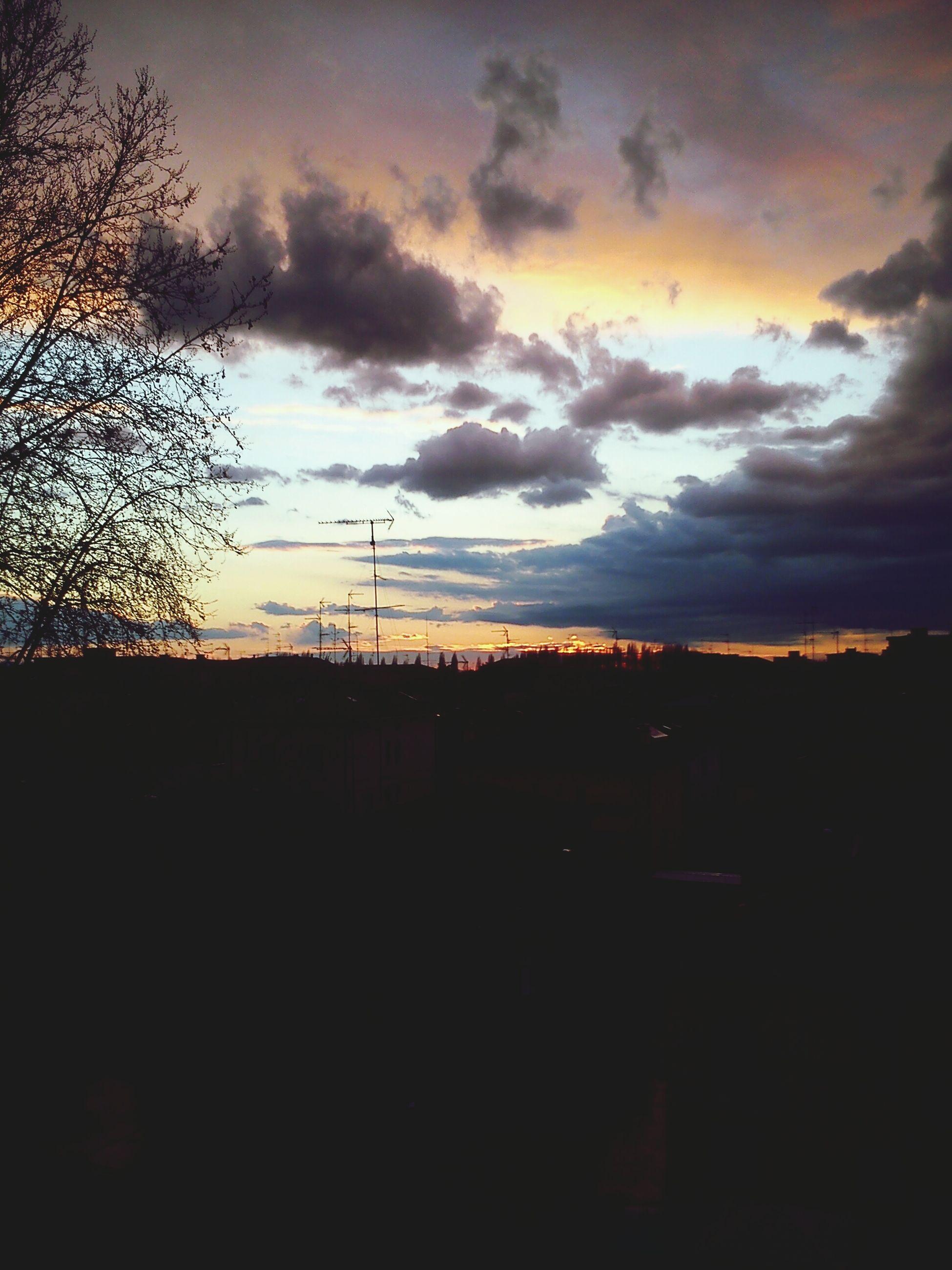 sunset, silhouette, sky, cloud - sky, orange color, scenics, beauty in nature, tranquility, tranquil scene, tree, landscape, nature, cloud, built structure, dark, cloudy, electricity pylon, idyllic, dusk, building exterior