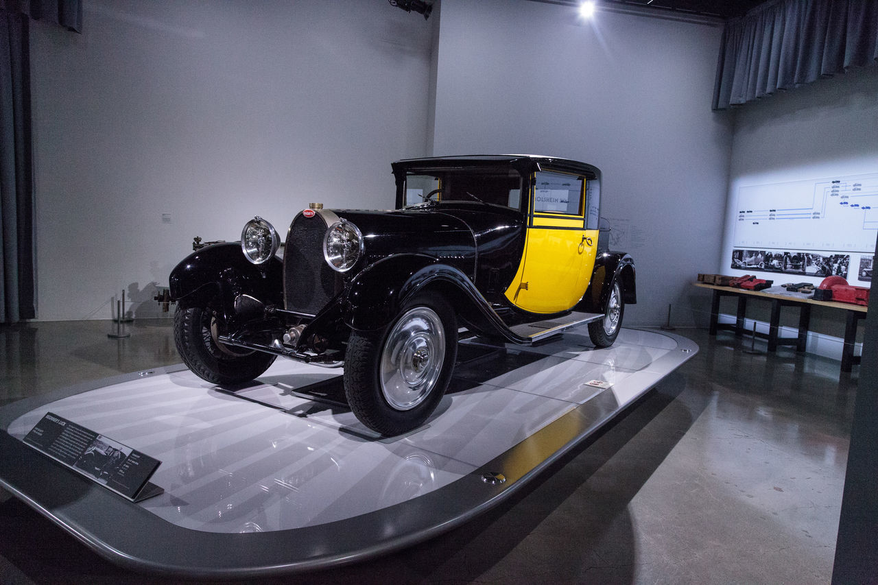 Los Angeles, CA, USA - March 4, 2017: Yellow and black 1929 Bugatti Type 44 Fiacre at the Petersen Automotive Museum in Los Angeles, California, United States. Editorial only. 1929 Antique Automobile Black Bugatti Classic Car Day Fiacre Indoors  Old Car Petersen Automotive Museum Technology Type 44 Yellow