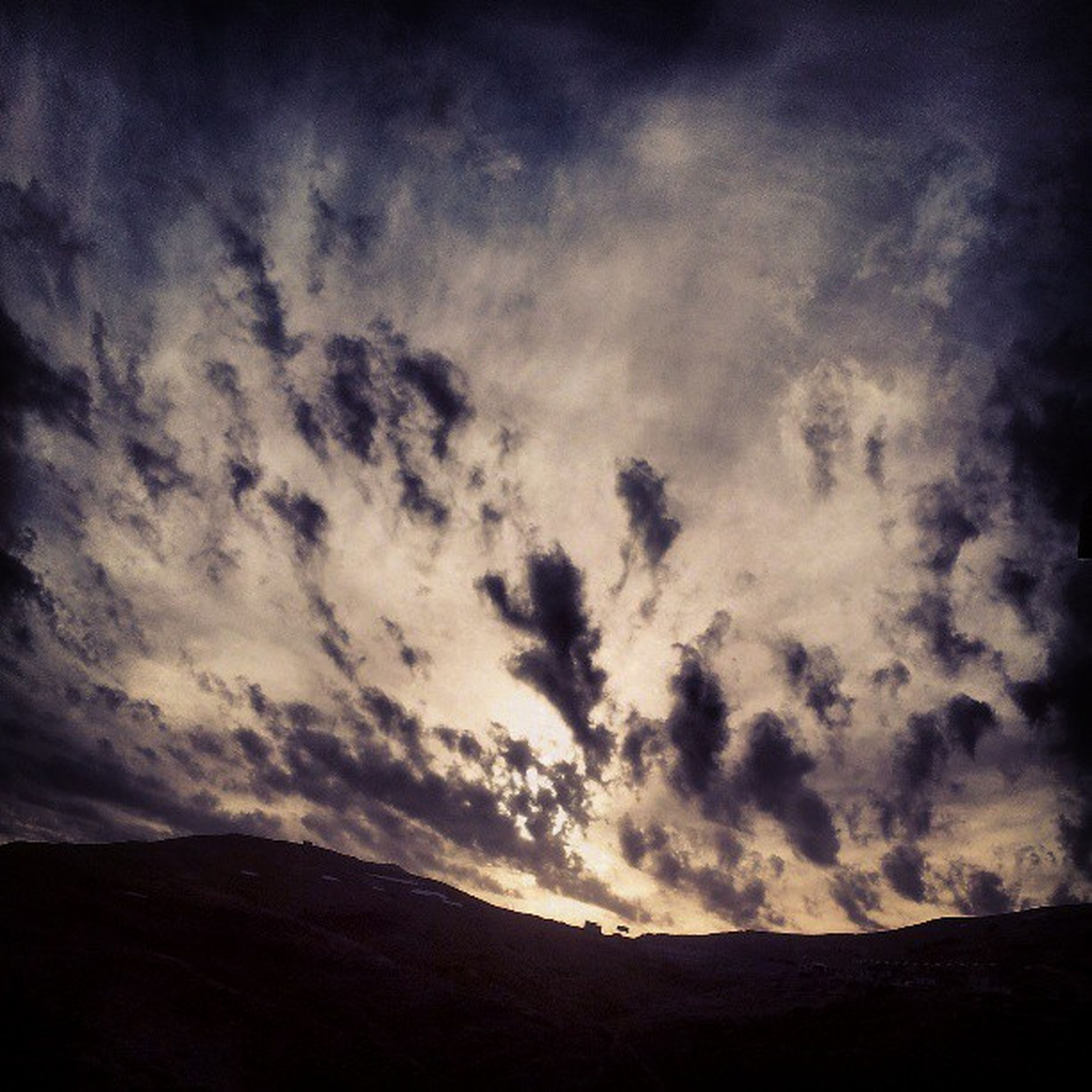 sky, tranquil scene, tranquility, scenics, cloud - sky, beauty in nature, cloudy, nature, cloud, landscape, low angle view, silhouette, mountain, idyllic, outdoors, non-urban scene, remote, no people, weather, dusk