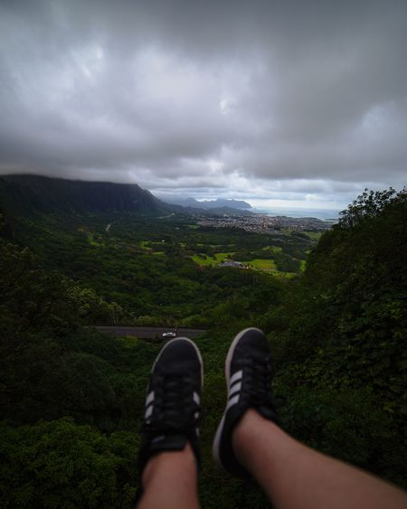 Human Body Part Personal Perspective Human Leg Shoe Cloud - Sky Dramatic Sky Low Section Point Of View Landscape One Person Hill People Grass Adult Nature Adults Only sky Sky Travel Destinations Outdoors Nature Horizon Over Water Close-up Day Oahu / Hawaii Honolulu, Hawaii
