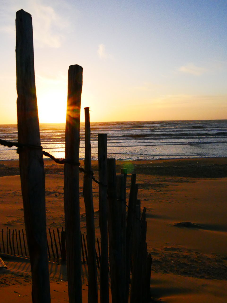 sea, sunset, scenics, nature, beauty in nature, tranquility, tranquil scene, horizon over water, beach, sky, no people, outdoors, water, wooden post, close-up, day