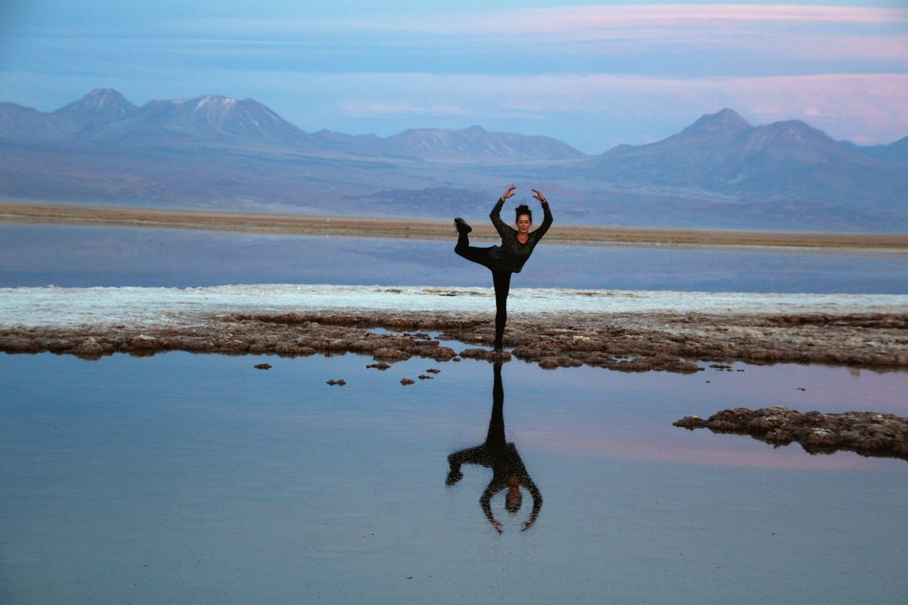 Beautiful stock photos of peaceful, 20-24 Years, Arms Raised, Balance, Casual Clothing