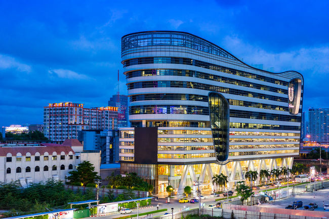 Bangkok, Thailand - July 1, 2016: Unilever House Building (Unilever Thailand) on Rama 9 Road in Twilight Time. Architecture Blue Building Exterior Building Story Built Structure City City Life Cloud - Sky Development Modern No People Office Building Outdoors Sky Skyscraper Tall - High Tower Urban Skyline