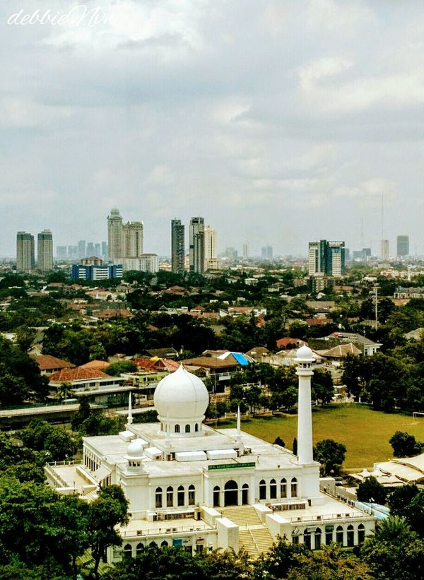 White Mosque in the city Dome Architecture City Building Exterior Built Structure Cityscape Business Finance And Industry Place Of Worship Social Issues No People Outdoors Day Jakarta Buildings Architecture Curved Buildings Sky Buildings & Sky Skyline Backgrounds Bluesky Windows Mosque Architecture Mosque White Wall City