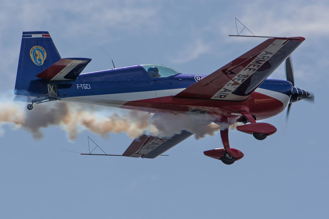 Aircraft Airplane Airshow Avion Blue Cloud Cloud - Sky Cloudy Day Extra EA-330SC Flight Flying Flying Spirit à Biscarrosse 2016 Low Angle View Meeting Nature No People Outdoors Pole Show Sky Smoke Sport Tilt Voltige