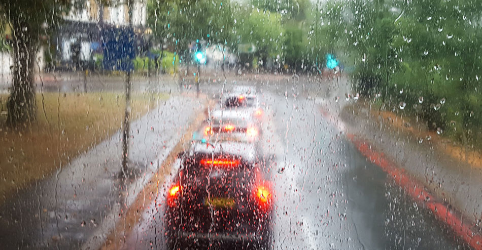 Brake Lights City Day Droplets London No People Outdoors Rain Road Street Traffic Traffic Lights Water Wet Window Cars