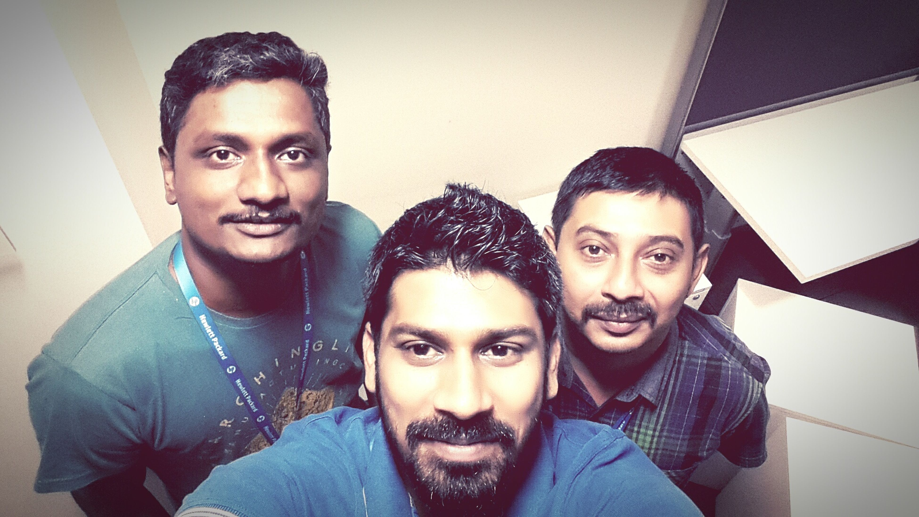 looking at camera, portrait, person, lifestyles, young adult, smiling, front view, togetherness, happiness, indoors, leisure activity, young men, casual clothing, bonding, mid adult, headshot