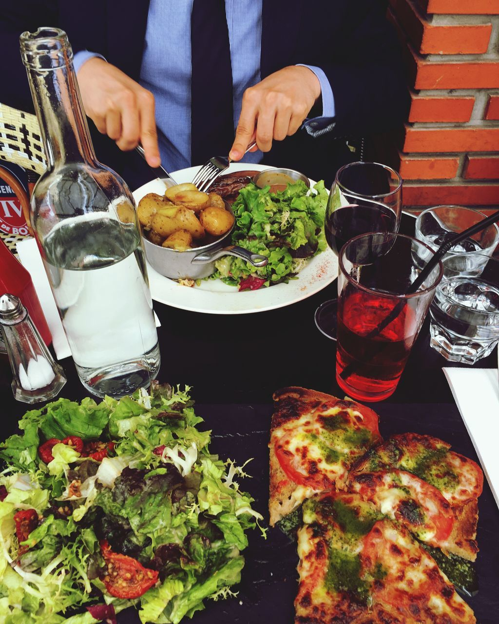 food and drink, food, real people, midsection, salad, freshness, healthy eating, plate, men, wine, table, human hand, wineglass, holding, red wine, fork, drink, meal, serving size, lifestyles, indoors, drinking glass, ready-to-eat, close-up, day, adult, people