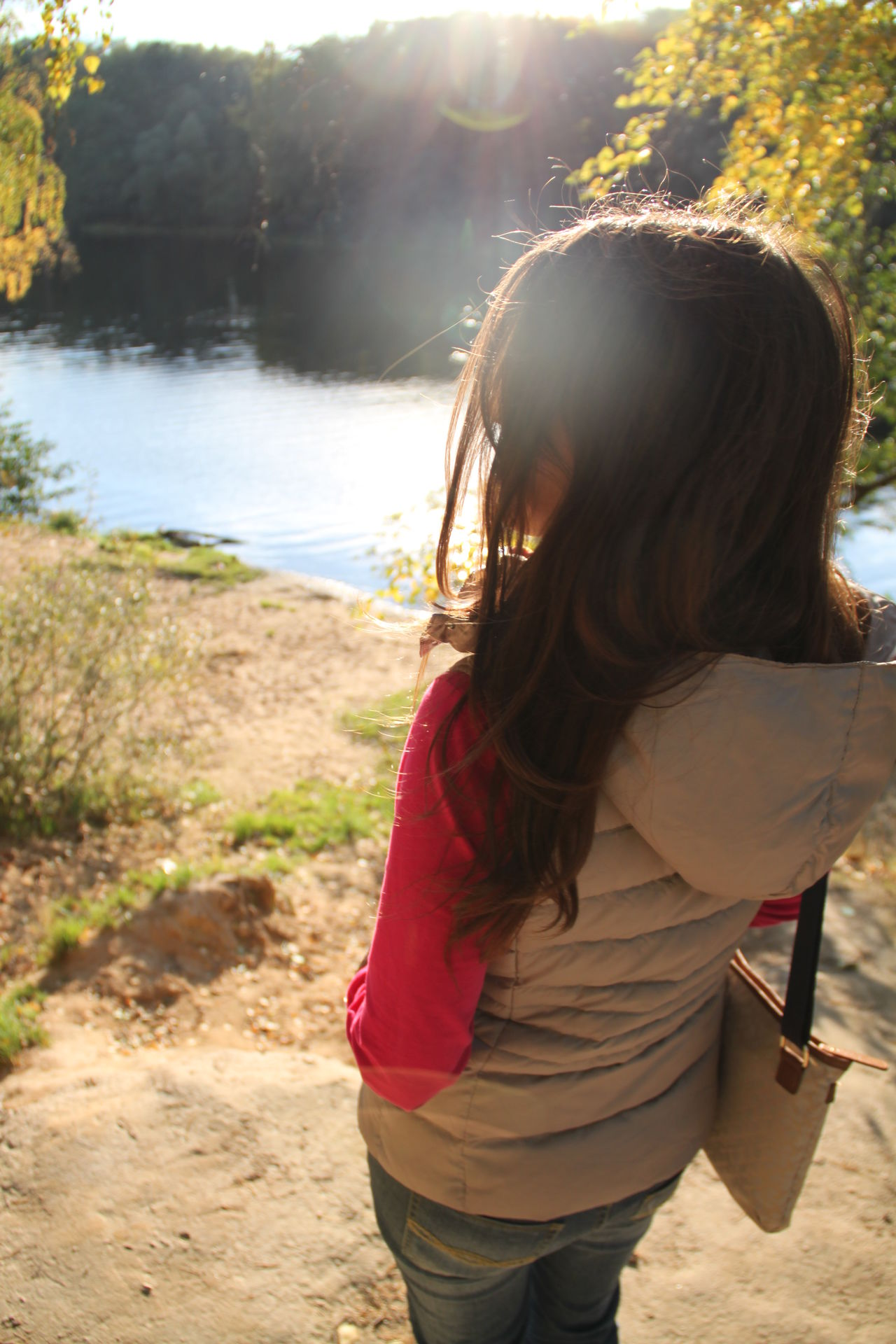 Autumn Back Lit Brown Hair Forest Lake Long Hair Nature One Person Only Women Outdoors Portrait Rear View Standing Sunlight Unrecognizable Person Young Women
