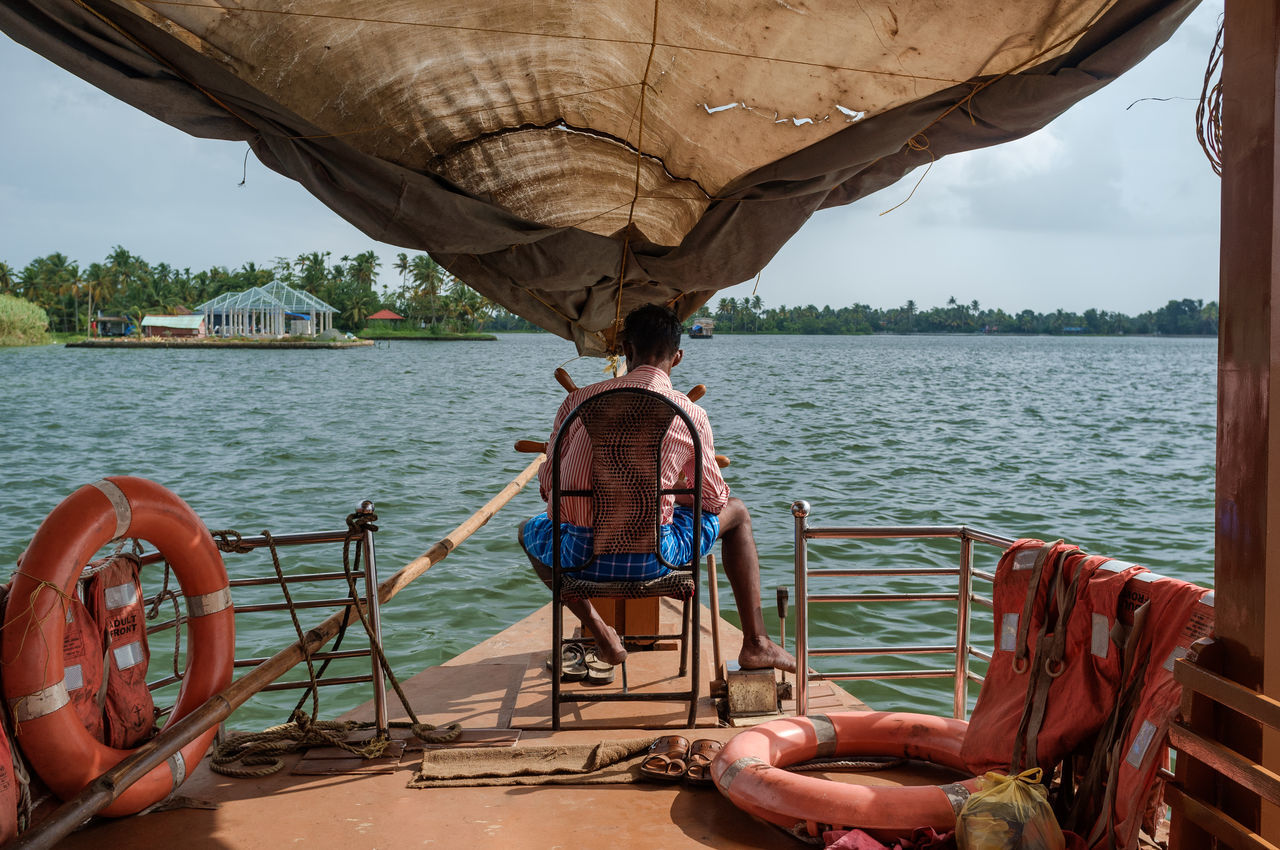 real people, water, boat, nautical vessel, transportation, mode of transport, day, nature, men, outdoors, sea, one person, sailing, beauty in nature, sky