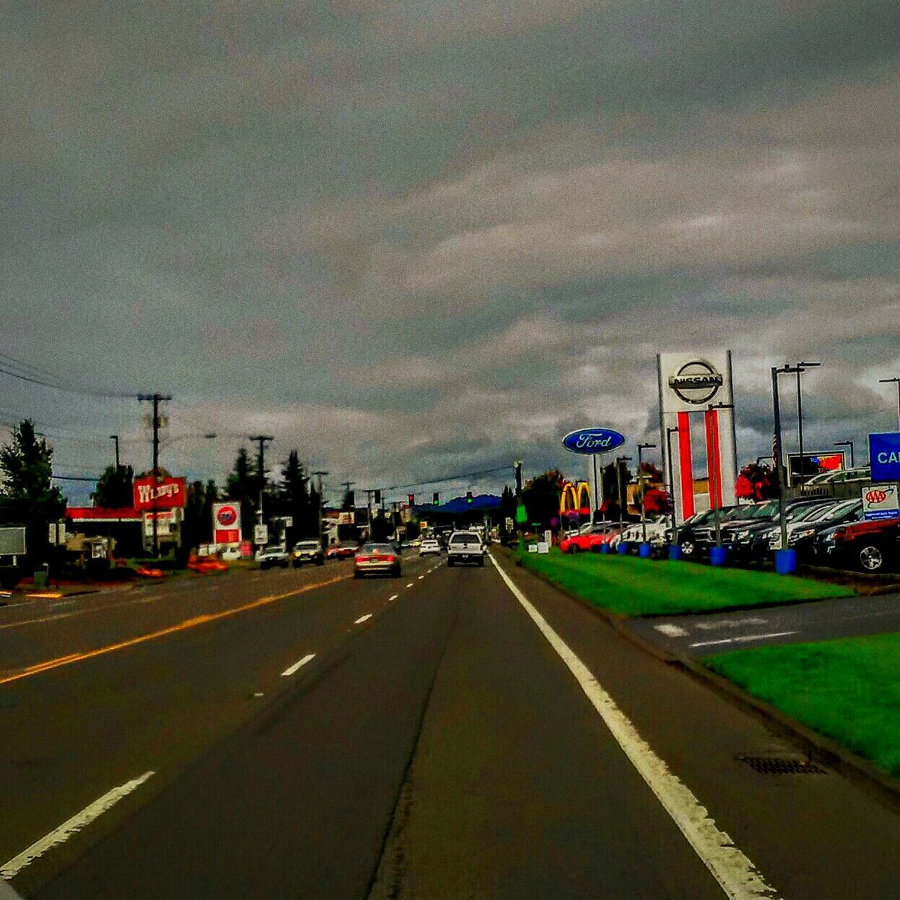 Welcome to the Quiet & Sleepy Town of McMinnville, Oregon . This is the Main Strip or Downtown you could even call it Uptown its a Bustling Busy Area of Town. Enjoying The View My Home Cloudy Morning Funnel Cloud Advisory is Still in Effect Yikes! But Seriously im not Scared . I hope you all have a Wondetful Day Hanging Out