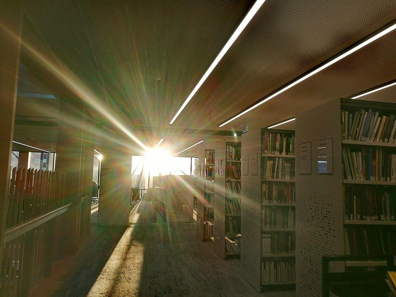 indoors, illuminated, architecture, library, bookshelf, no people, day