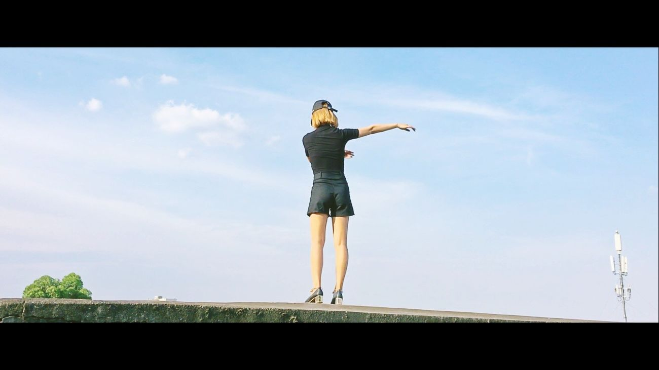 Full Length One Person Standing Sky Young Adult Cloud - Sky Leisure Activity Young Women Day Real People One Young Woman Only Low Angle View Women One Woman Only Outdoors Adult Adults Only People