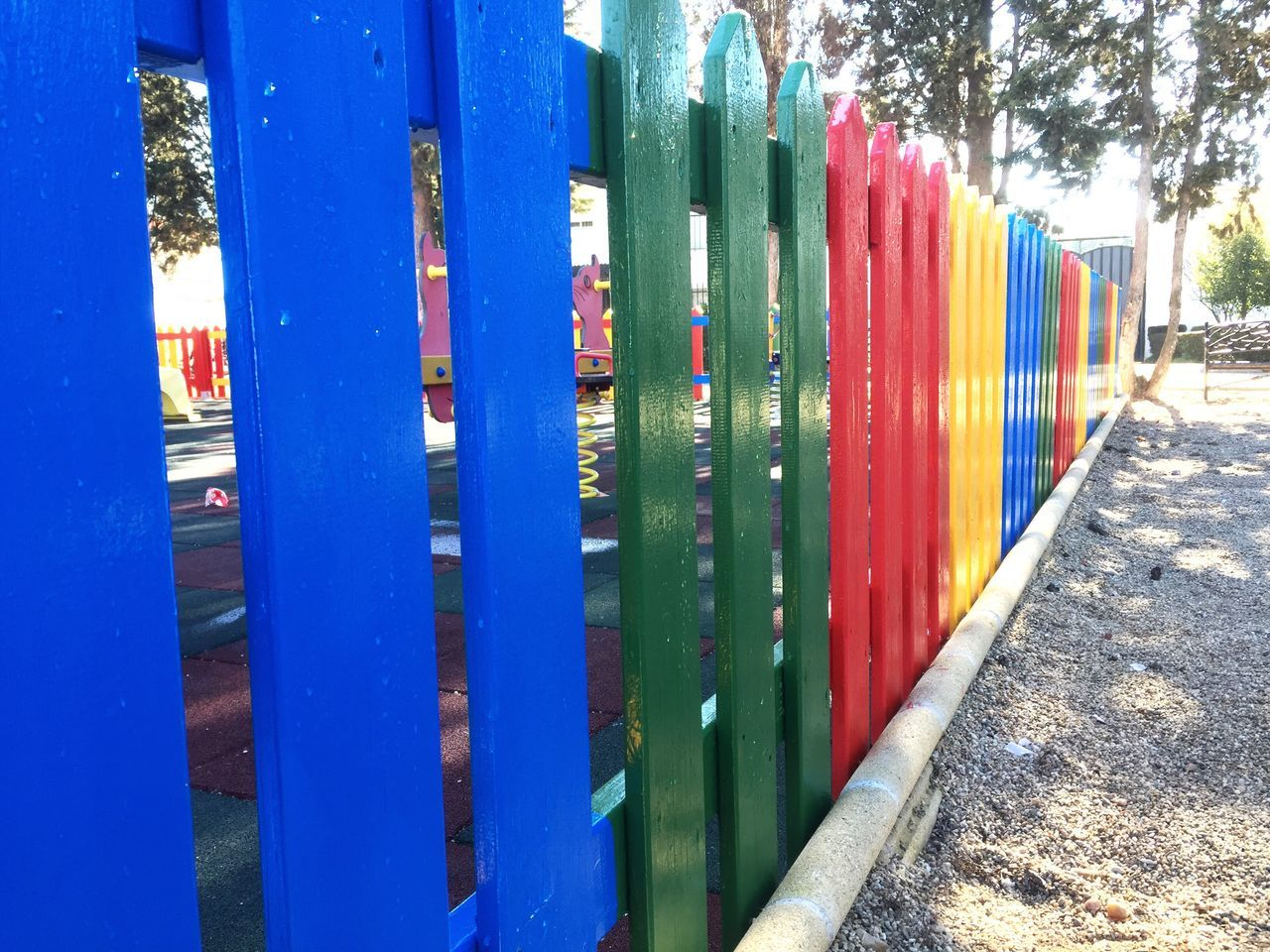 Multi Colored Multicolors  Color Colors Colorful Park Park - Man Made Space Outdoors No People Close-up Rural Scenes From My Point Of View Playground Adapted To The City Fence Wooden Wooden Fence Organized Organization Street Tranquil Scene Cityscape Architecture Color Palette Urban