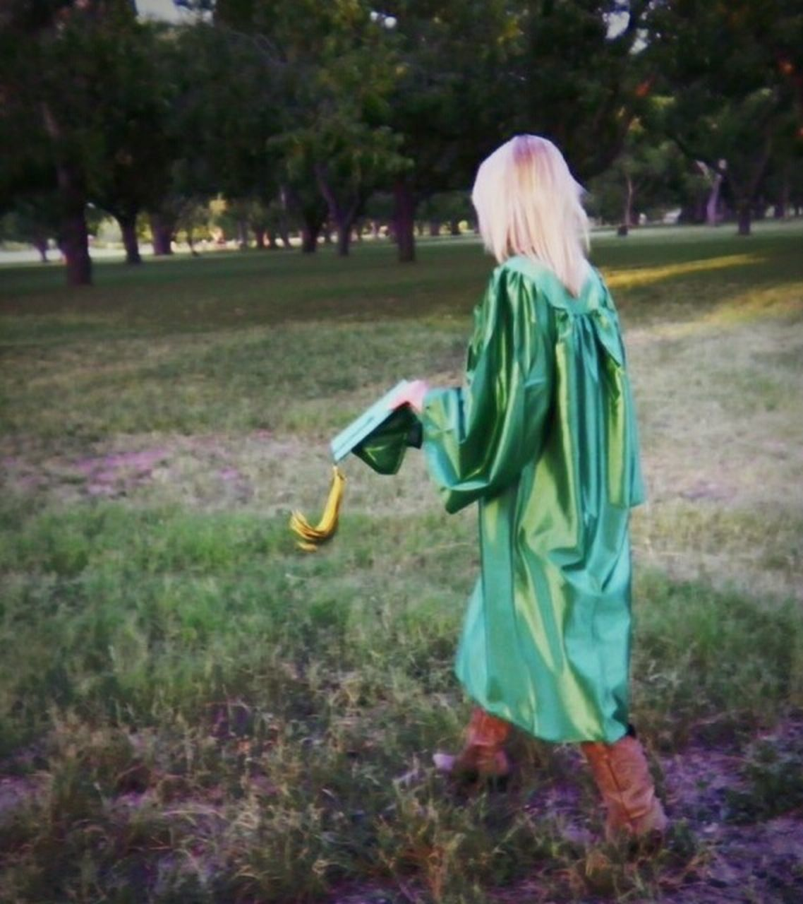 childhood, one person, rear view, blond hair, holding, girls, full length, child, leisure activity, real people, elementary age, children only, grass, outdoors, lifestyles, day, nature, tree, people, adult