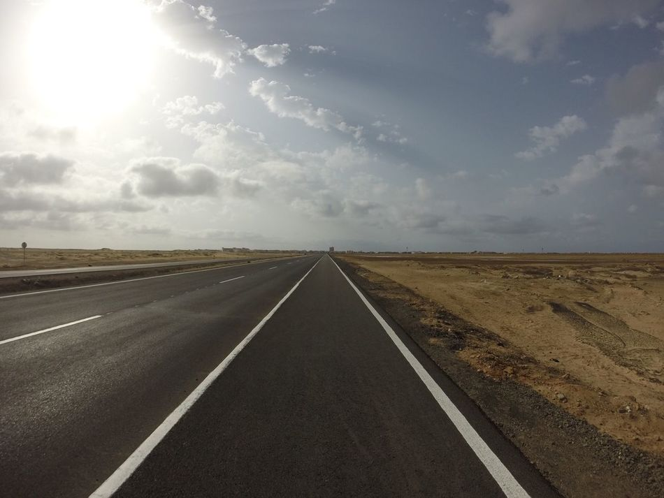 A Long Straight Road & Walking Path...x Road The Way Forward Diminishing Perspective Sky Transportation Landscape No People Outdoors Day Straight Nature First Eyeem Photo Cape Verde Sal Desert Lonely Santa Maria Long Road
