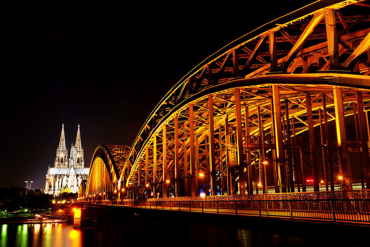 Hohenzollern Bridge And Cologne Cathedral Against Clear Sky At Night