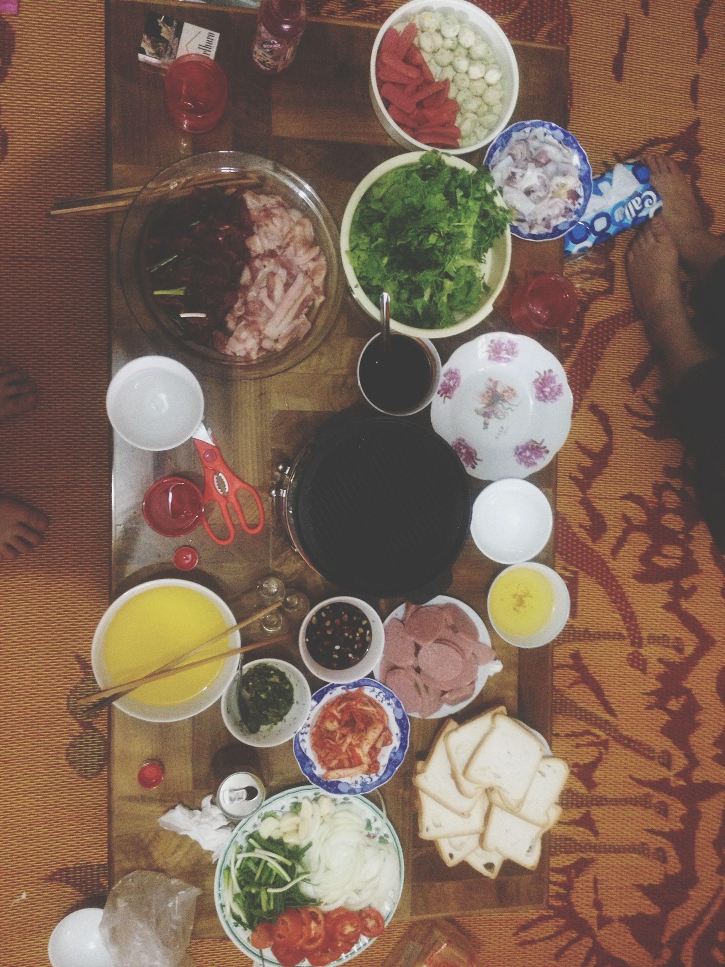 table, food and drink, indoors, still life, freshness, food, drink, high angle view, plate, bowl, variation, refreshment, drinking glass, healthy eating, ready-to-eat, arrangement, no people, wood - material, directly above, indulgence