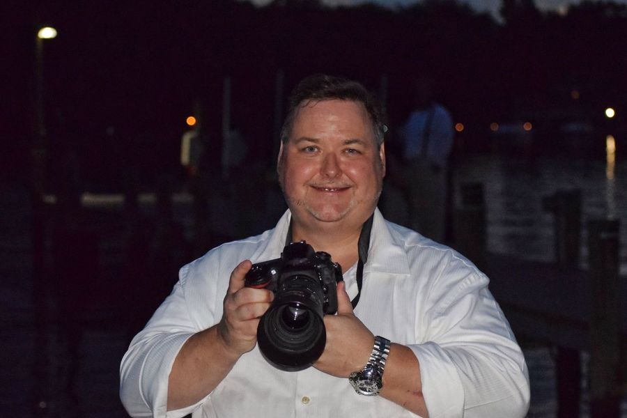 Portrait One Man Only Looking At Camera Camera - Photographic Equipment One Person Smiling Mature Adult Photography Themes Mature Men Photographer Only Men Holding Adult Happiness Photographing Illuminated Adults Only Outdoors Men Night Wedding Photography