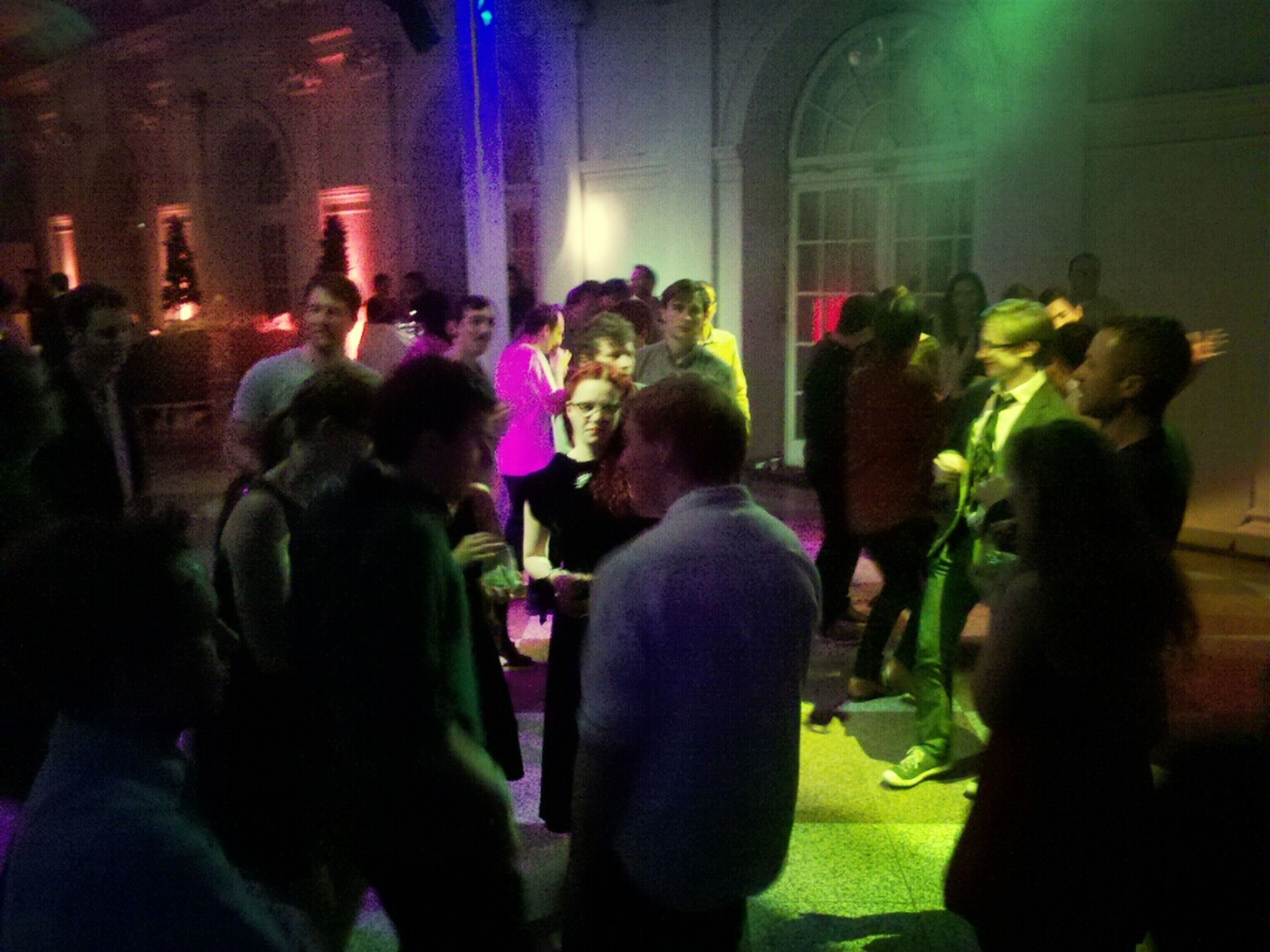 large group of people, lifestyles, illuminated, men, person, crowd, leisure activity, night, indoors, togetherness, arts culture and entertainment, enjoyment, nightlife, event, fun, music, performance, music festival