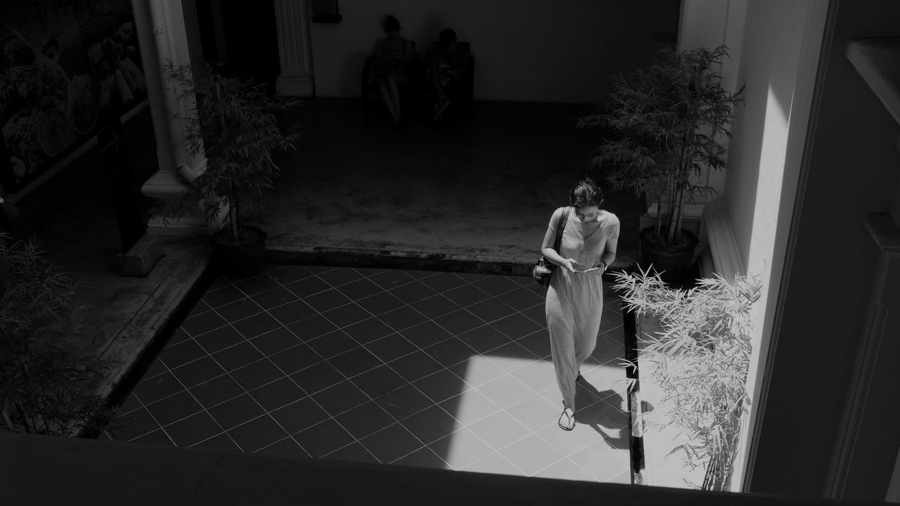 in the museum Fine Art Photography Black And White ASIA Travel Photography Streetphotography B&w Street Photography Light And Shadow Phuket Thailand One Person Young Woman Walking On The Phone Shot From Above  Out From The Shadows Historical Building In The Museum One Piece Outfit Fashion Strideby Chasing Harsh Light Looking Down Wanderlust Fujifilm_xseries Everybodystreet Spotted In Thailand