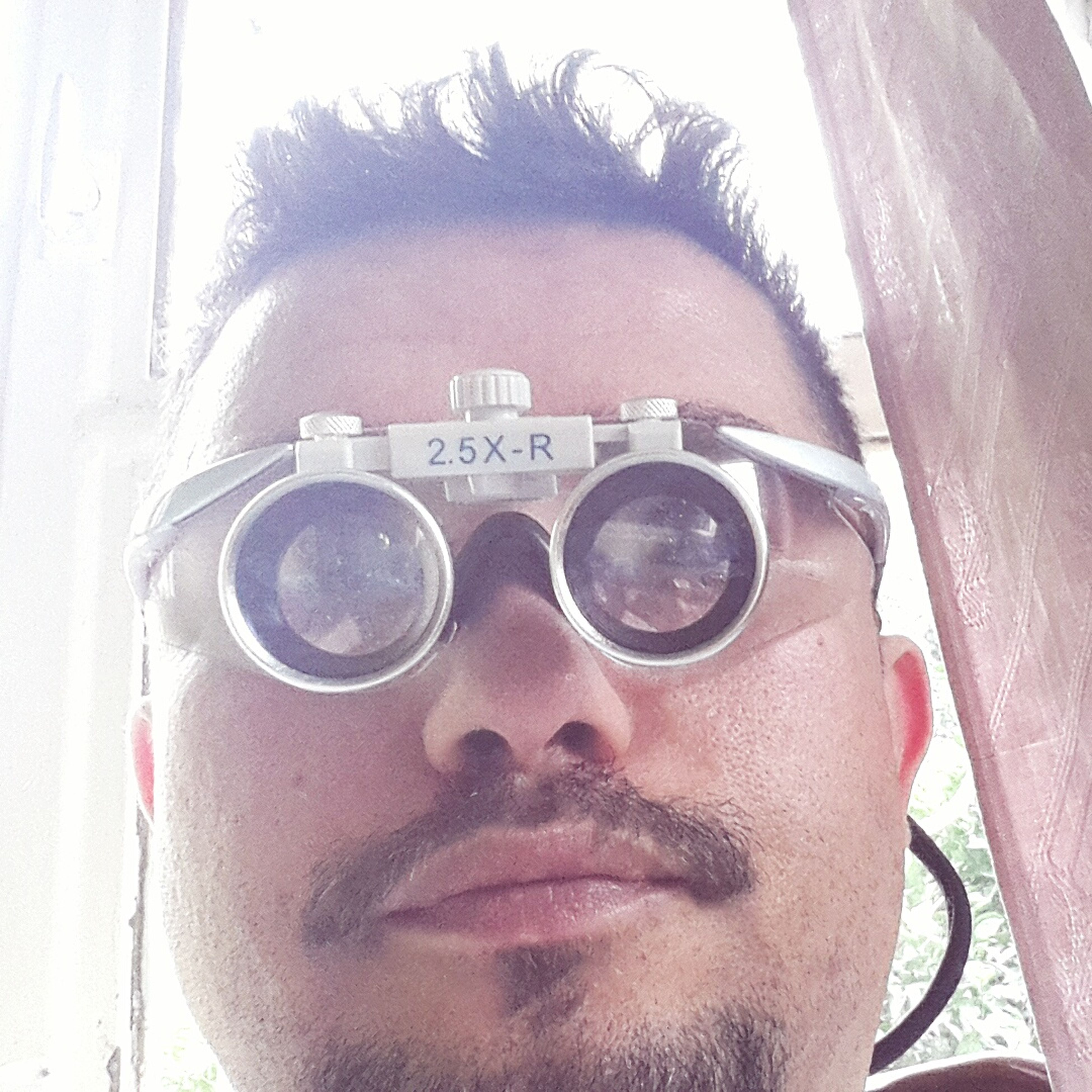 communication, text, headshot, lifestyles, close-up, western script, leisure activity, sunglasses, person, young adult, front view, photography themes, holding, young men, looking at camera, indoors, reflection