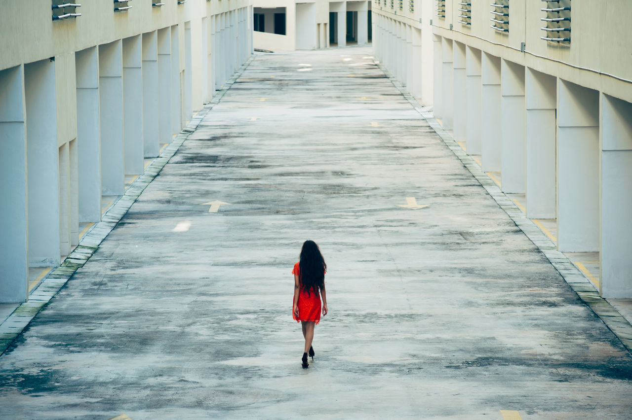 Adult Architecture Built Structure Day Long Hair One Person Outdoors People Real People Red Dress Road The Way Forward Urban Exploration Young Women