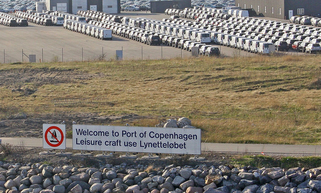 A Taste Of Copenhagen Cars Ready To Be Shipped Lanelinie Pier Copenhagen Welcome To Copenhagen Sign Communication Day Grass Nature No People Outdoors Text Water Port Of Copenhagen New Cars