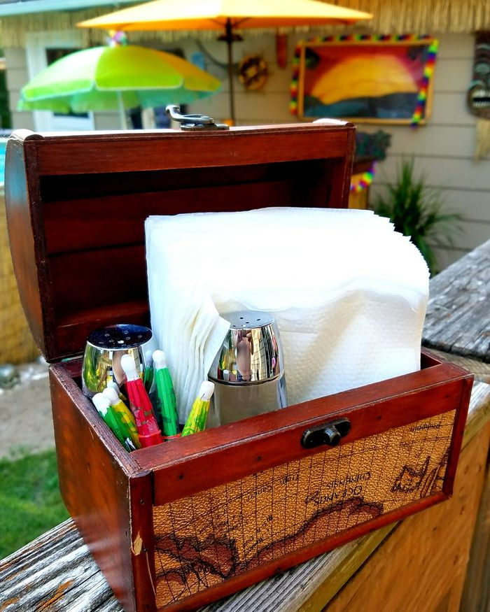 Backyard necessity storage Hanging Out Backyard Napkins Napkin Holder Salt And Pepper Shakers Tiki Bar Canman Show Studio Treasure Chest Relaxing Iowa Cedar Rapids