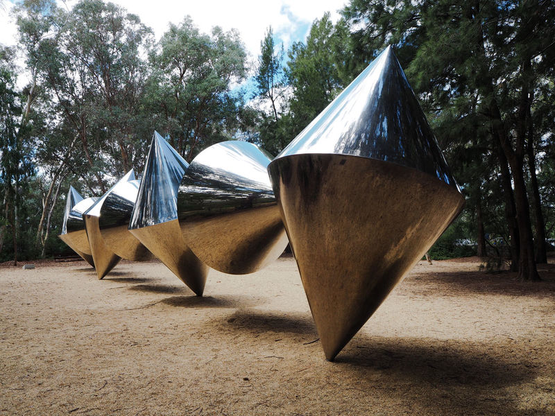 """If you come to Canberra, the NGA is absolutely worth visiting it. Even outside it's quite a experience. Her you see Herbert 'Bert' Flugelman's """"Cones"""" in the National Gallery of Australia's Sculpture Garden Art Art Gallery Art, Drawing, Creativity ArtWork Form Full Length Garden Gardens Metal Metallic Mirror Mirrored Park Parks Pattern, Texture, Shape And Form Reflection Reflections Sculpture Sculptures Shiny Travel Travel Photography Traveling Travelling"""