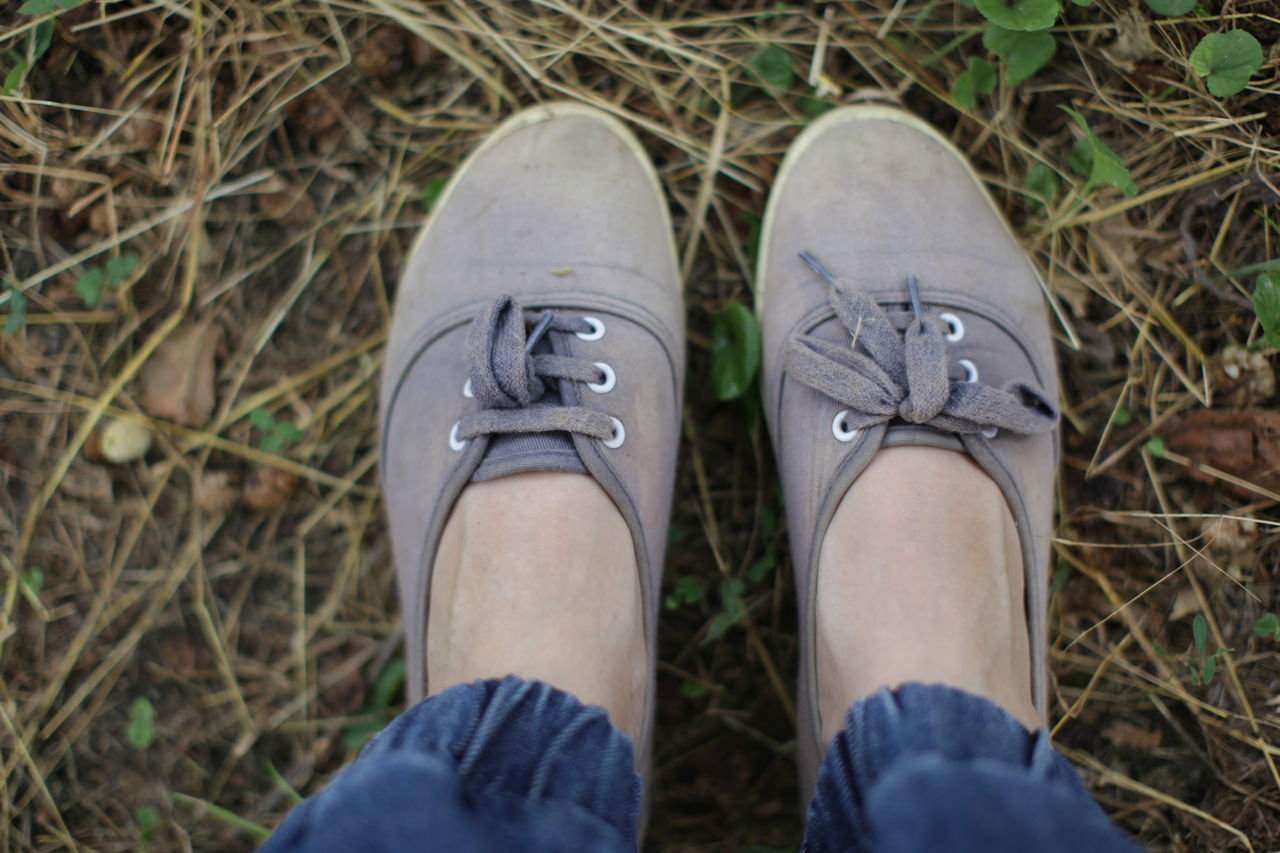 Village style Footwear Human Body Part Human Foot Human Leg Jeans Lifestyles Old Old Shoes Relaxed Shoe Standing Village Village Life