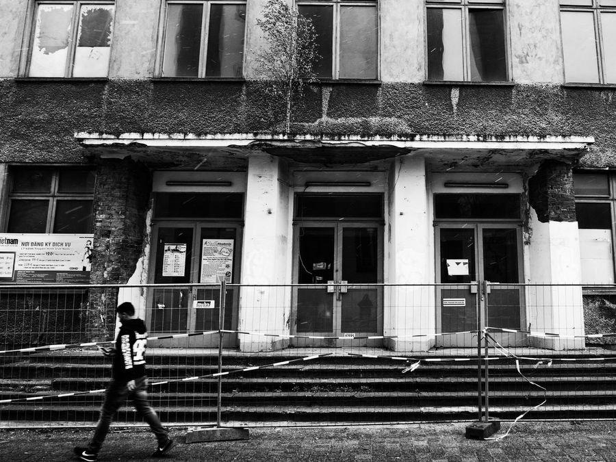 Decay Dong Xuan Center Berlin Dong Xuan Market Gritty Hurrying Man Old Rain Raining Rainy Days Tree On Building