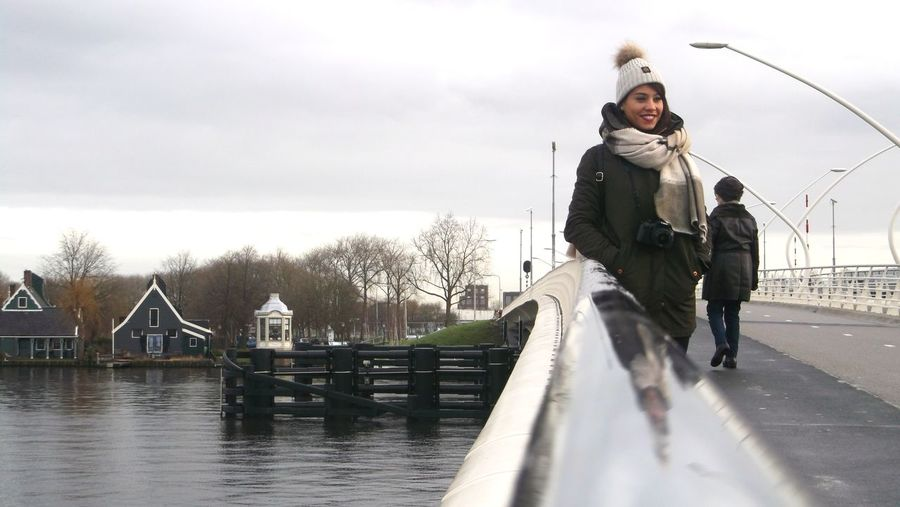 When she smiles Winter Outdoors People Bridge - Man Made Structure Full Length Water Day Nature Sky Architecture People And Places. Candid Photography Ditchstyle Streetview Geometric Shape Pattern Pieces Asymetrical EyeEm Gallery Simple Beauty The Week On EyeEem Mobilephotography Uniqueness The Street Photographer - 2017 EyeEm Awards