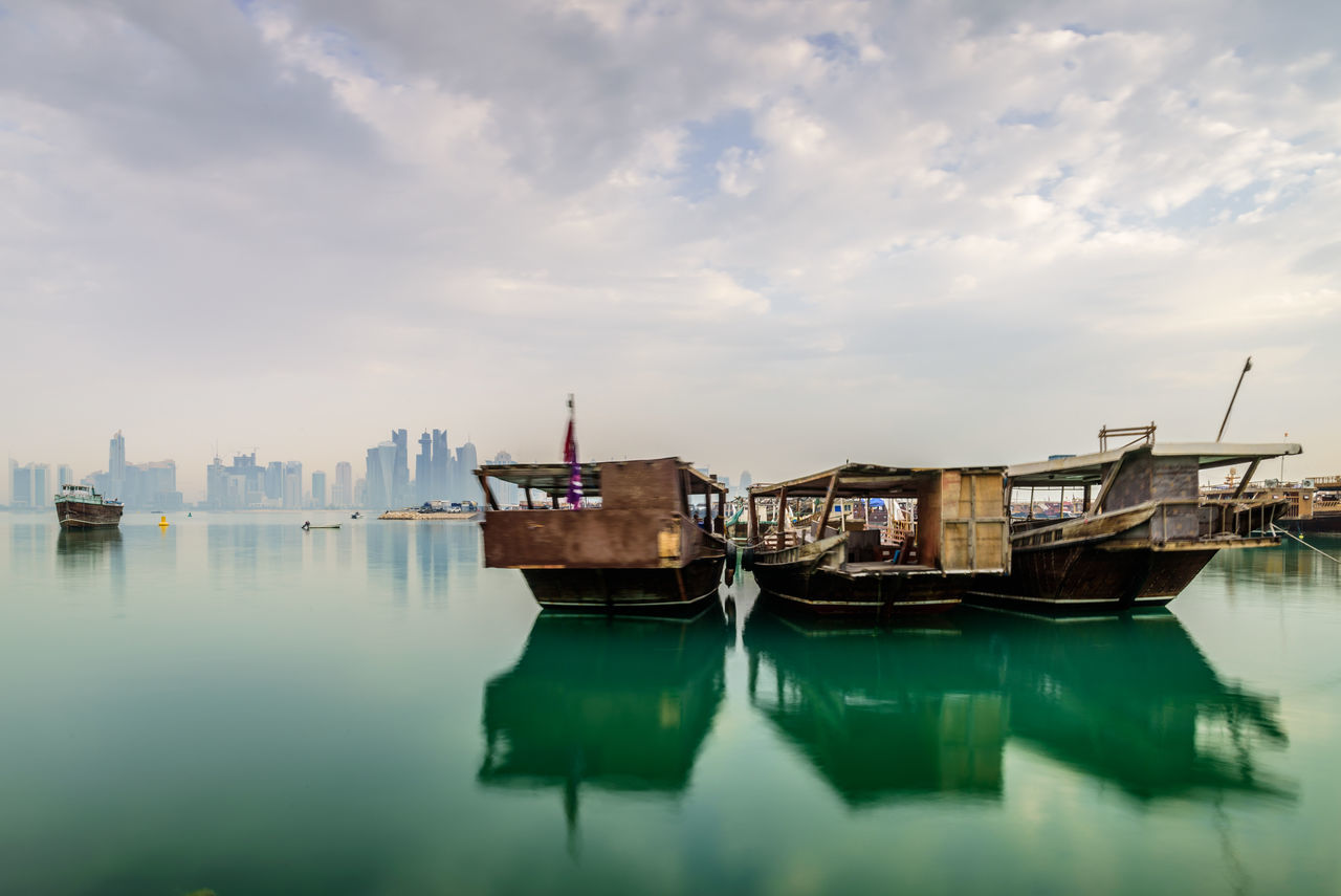 Traditional Qatar Dhows with Doha City background Beautiful Boat Capital City Cloud Corniche Dhow Dog Gulf Nature Qatar Reflection Sky Sky And Clouds Skyline Skyscraper Traditional