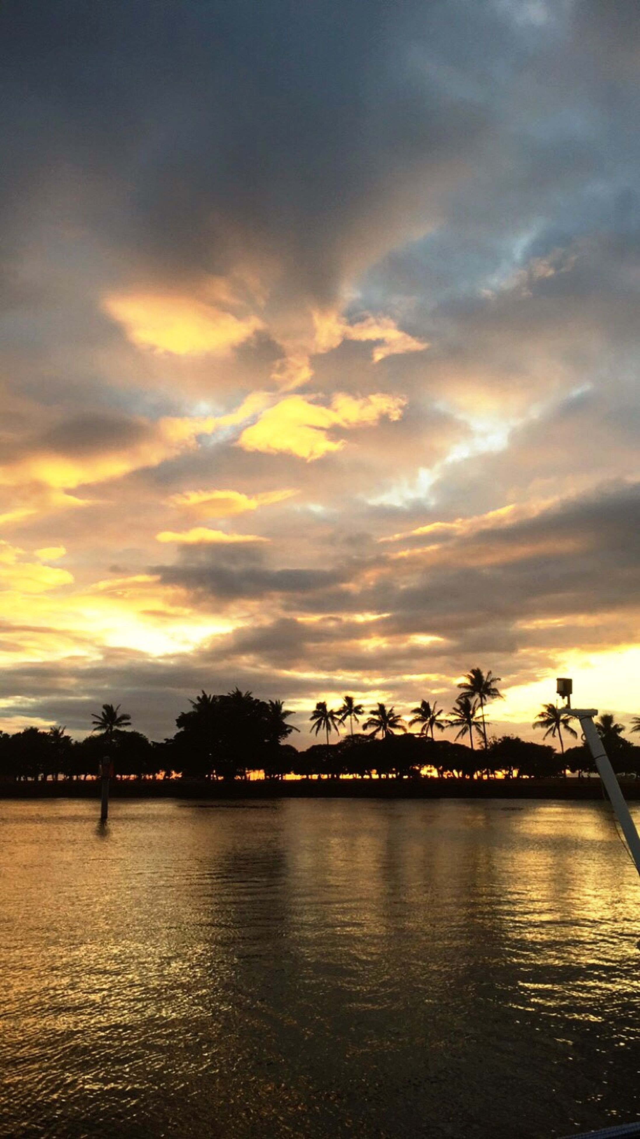 sunset, sky, water, cloud - sky, silhouette, waterfront, scenics, beauty in nature, tranquility, tranquil scene, cloudy, orange color, tree, river, cloud, nature, dramatic sky, reflection, idyllic, dusk