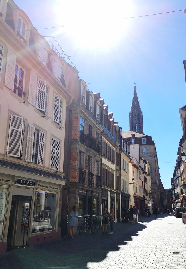 Architecture Building Exterior Built Structure Street Road Sun Clear Sky Sunlight Transportation City Building Day The Way Forward Sunny Sky Sunbeam Outdoors Lens Flare Footpath Streetphotography Walking Around Strasbourg France Europe City Life