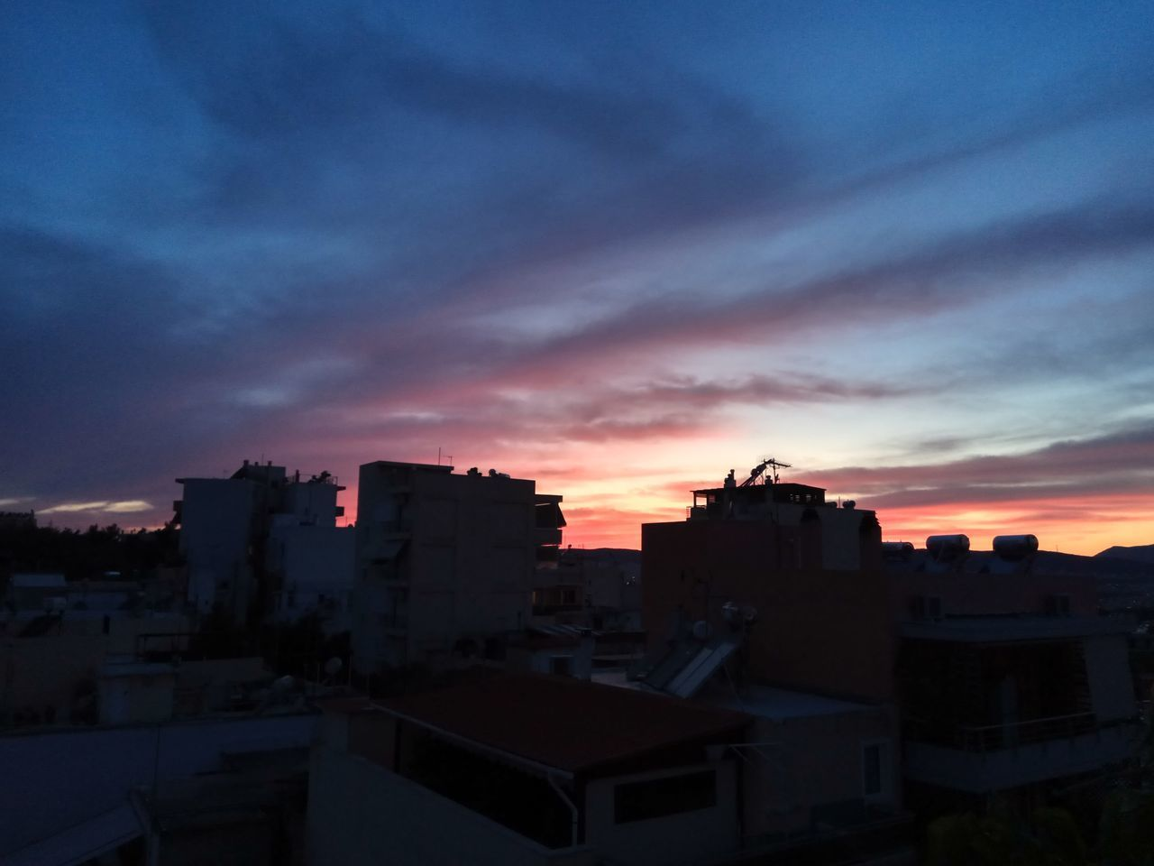 architecture, sunset, building exterior, built structure, sky, no people, outdoors, cityscape, nature, city