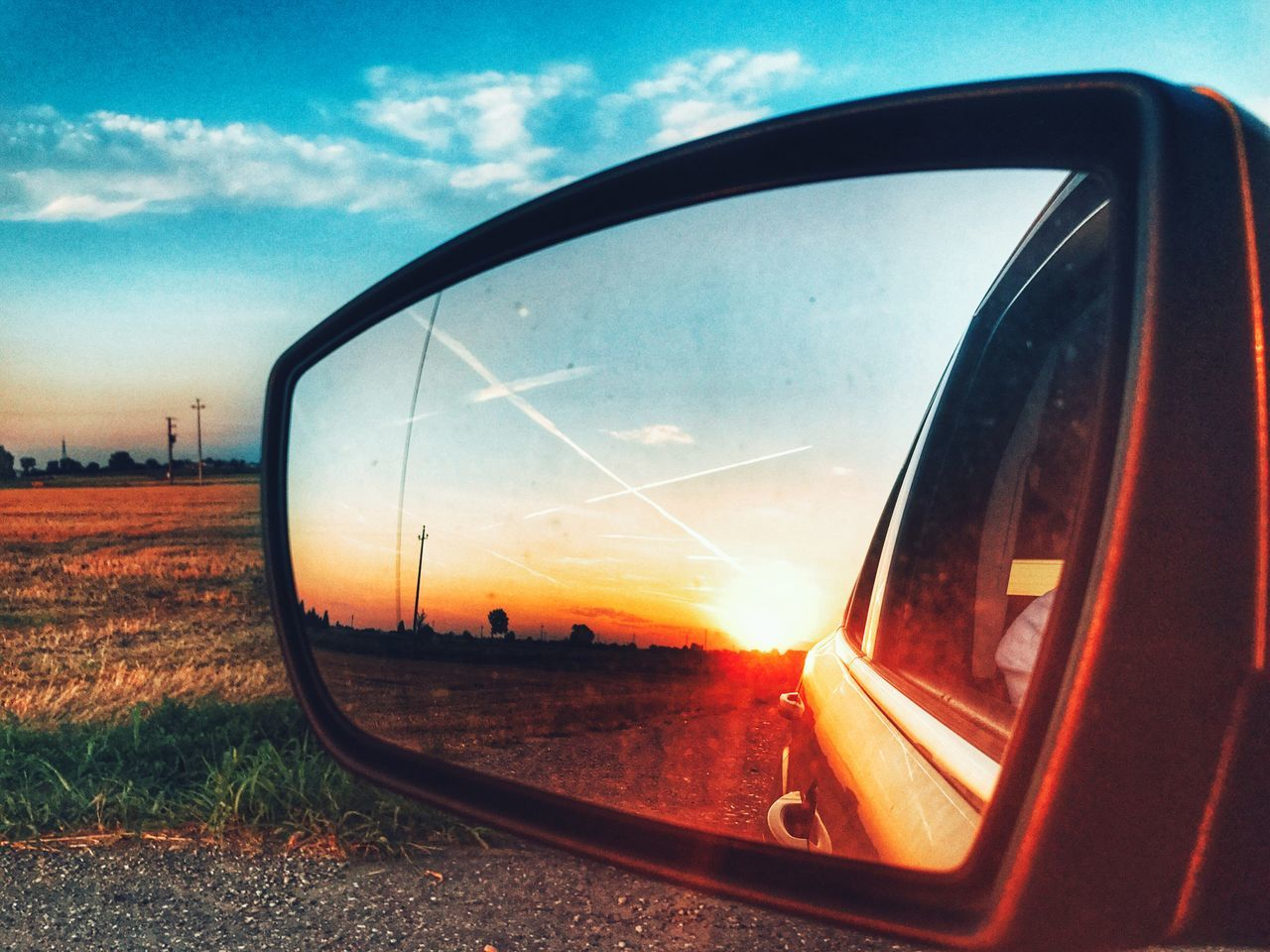 side-view mirror, transportation, window, sky, reflection, no people, landscape, nature, sunset, outdoors, close-up, day