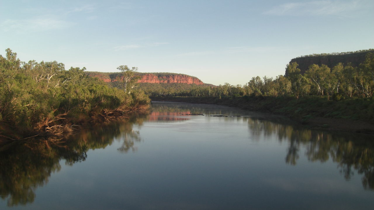 #amazing Moment Australia Backpacking #Beautiful Nature #earlymornings  #Kimberlys #NoFilter #outback #Peace And Quiet #redrock #river #roadtrip Bridge - Man Made Structure City Day Nature No People Outdoors Reflection Reflection Lake Scenics Sky Tree Water Miles Away