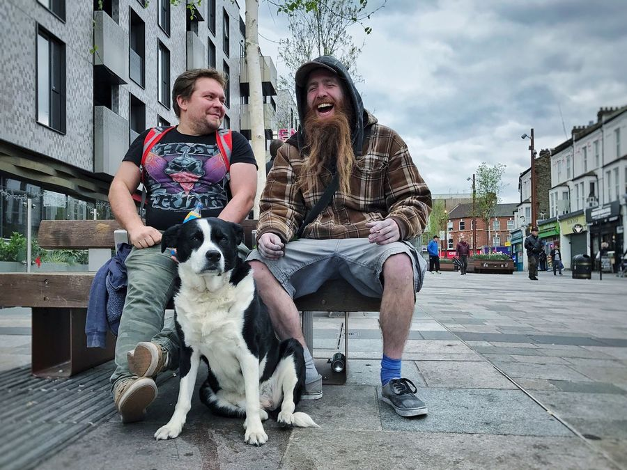 """Happiness isn't happiness without a violin-playing goat"" - Dog Pets Sitting Togetherness City Outdoors Two People Friendship Casual Clothing Real People Building Exterior Young Women City Life Bonding Day Young Adult Built Structure Portrait Couple - Relationship Lifestyles EyeEm Diversity Long Goodbye Break The Mold The Street Photographer The Street Photographer - 2017 EyeEm Awards Live For The Story"