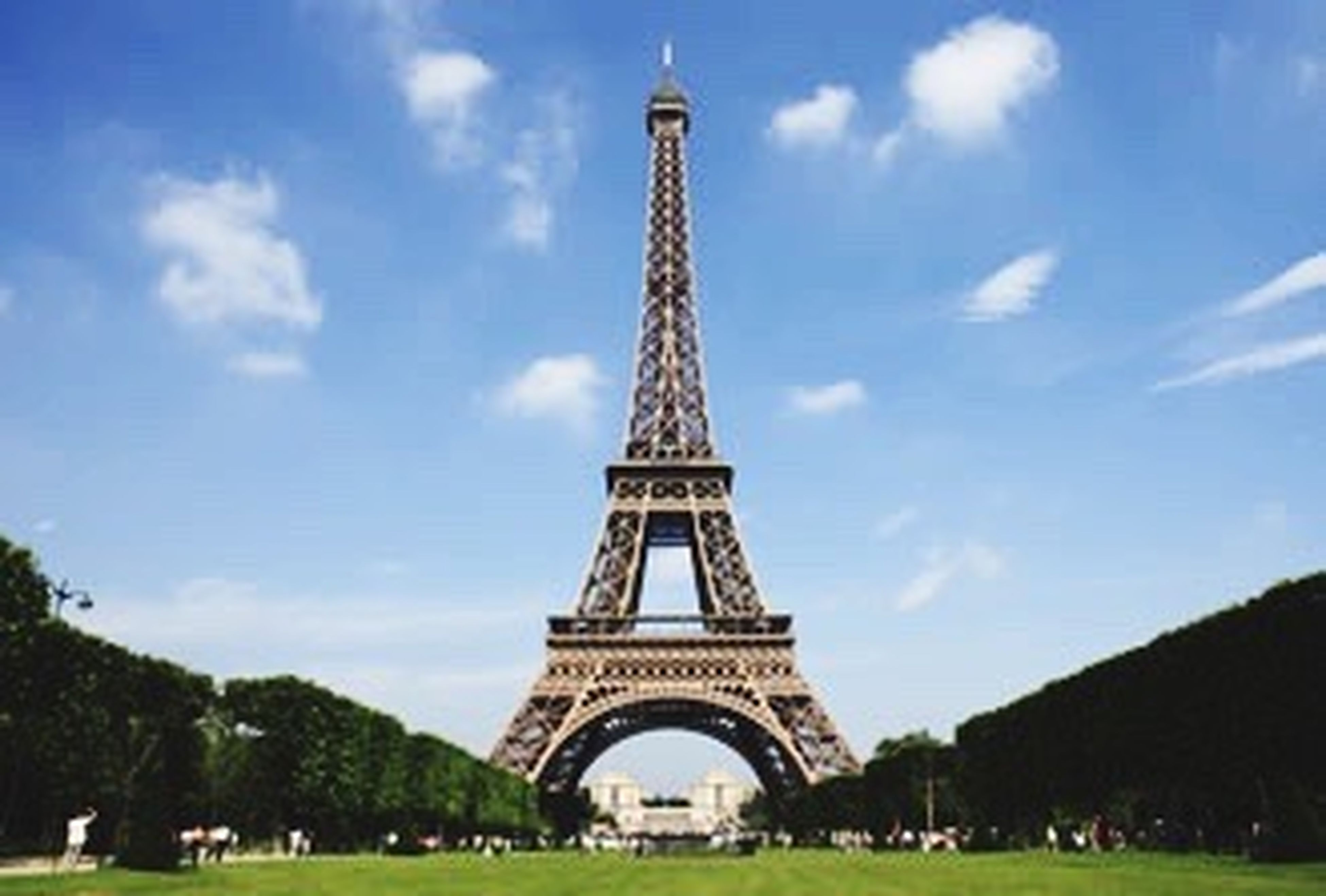 international landmark, travel destinations, tower, tourism, famous place, eiffel tower, travel, culture, capital cities, architecture, built structure, tall - high, history, sky, metal, tourist, arch, city, incidental people, vacations, iron - metal, lawn, architectural feature, monument, engineering, building exterior, tall, cloud, day, city life, outdoors, spire, 19th century style, cloud - sky