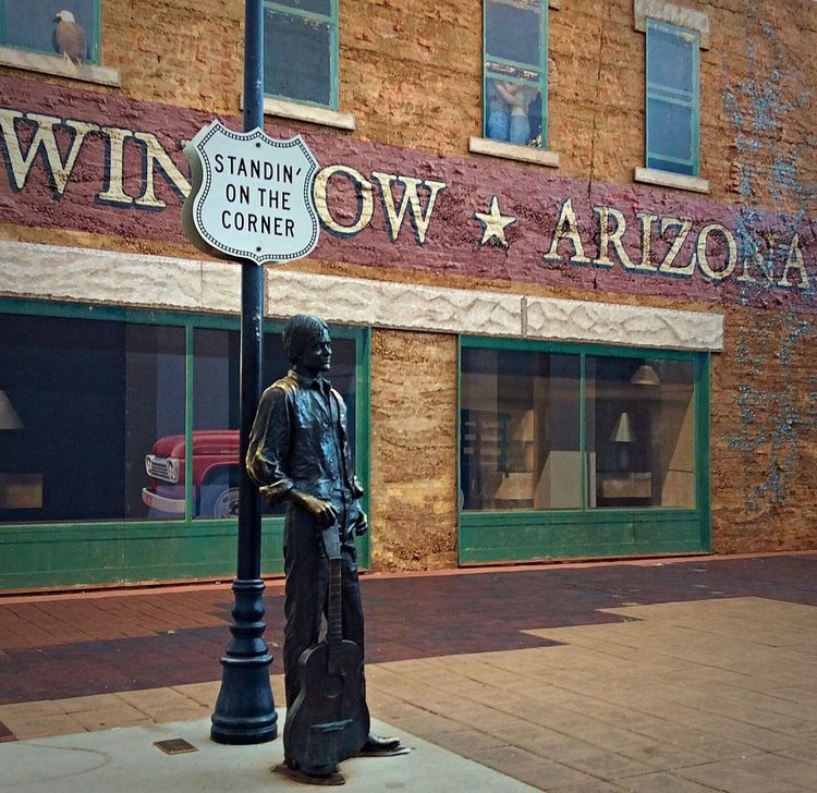 Building Exterior Architecture Built Structure Text Western Script Standing Side View Communication Full Length City Information Sign Roadside Sidewalk Arizona Tourism Candid Outdoors Day Profile Casual Statue Famous Place Famous The Eagles Take It Easy