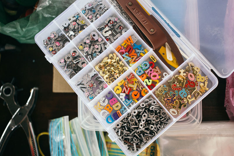 Accessories Art Box Charms Colorful Colors Cute Day DIY Large Group Of Objects Lifestyles Light And Shadow Multi Colored Name No People Numbers Souvenir Stationary Toolbox