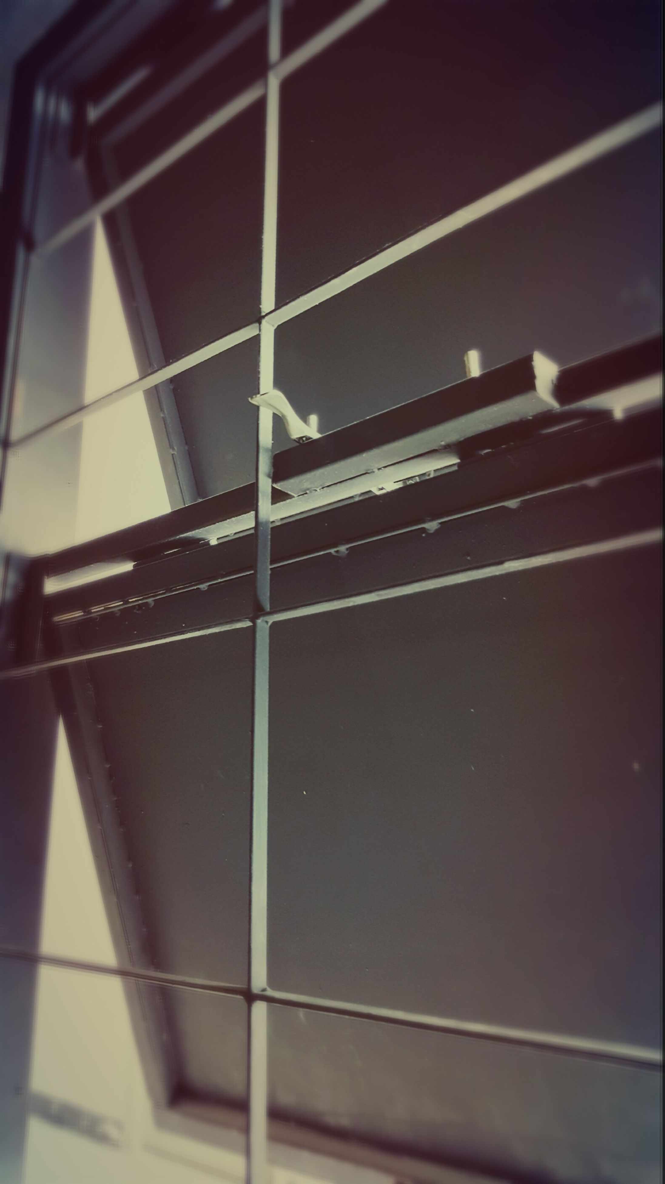 low angle view, architecture, built structure, indoors, building exterior, pattern, building, reflection, railing, window, modern, wall - building feature, no people, geometric shape, metal, glass - material, day, steps, wall, ceiling