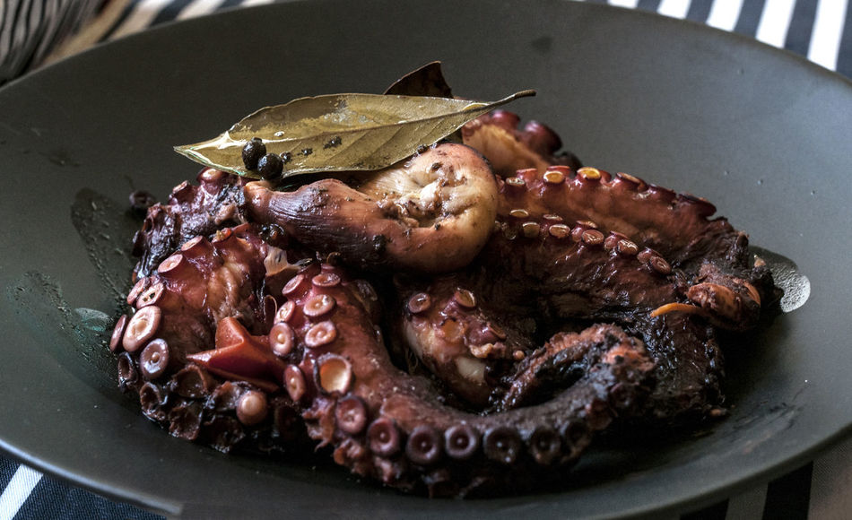 Octopus cooked with red wine, vinegar, bay leafs,Indian pepper, olive oil... Fasting Food Food Photography Foodphotography Foodporn Greek Cuisine Greek Food High Angle View Meal Mealtime Octopus On The Table Recipe Stew